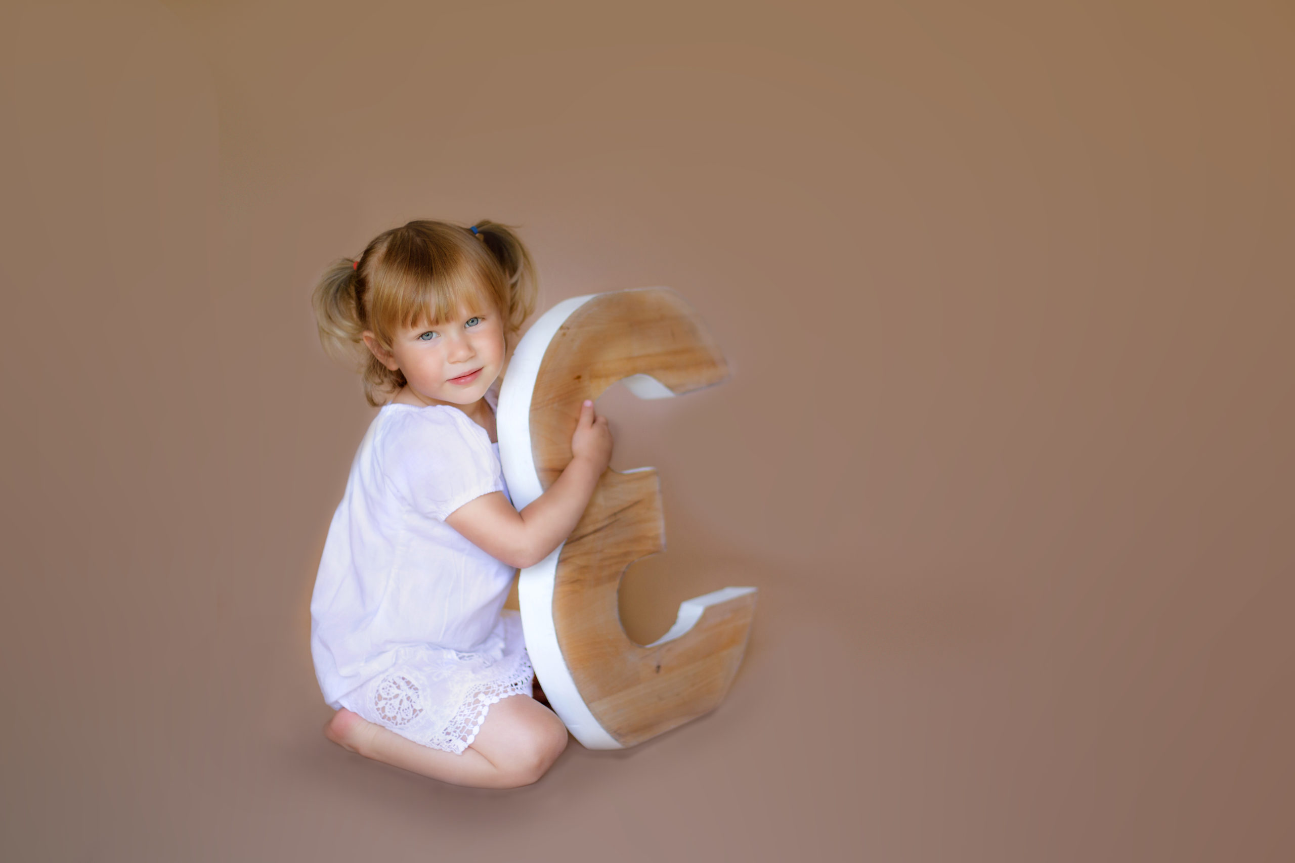Third birthday Studio Photo session girl in a white dress with a large number 3 in Wimbledon Photo Studio