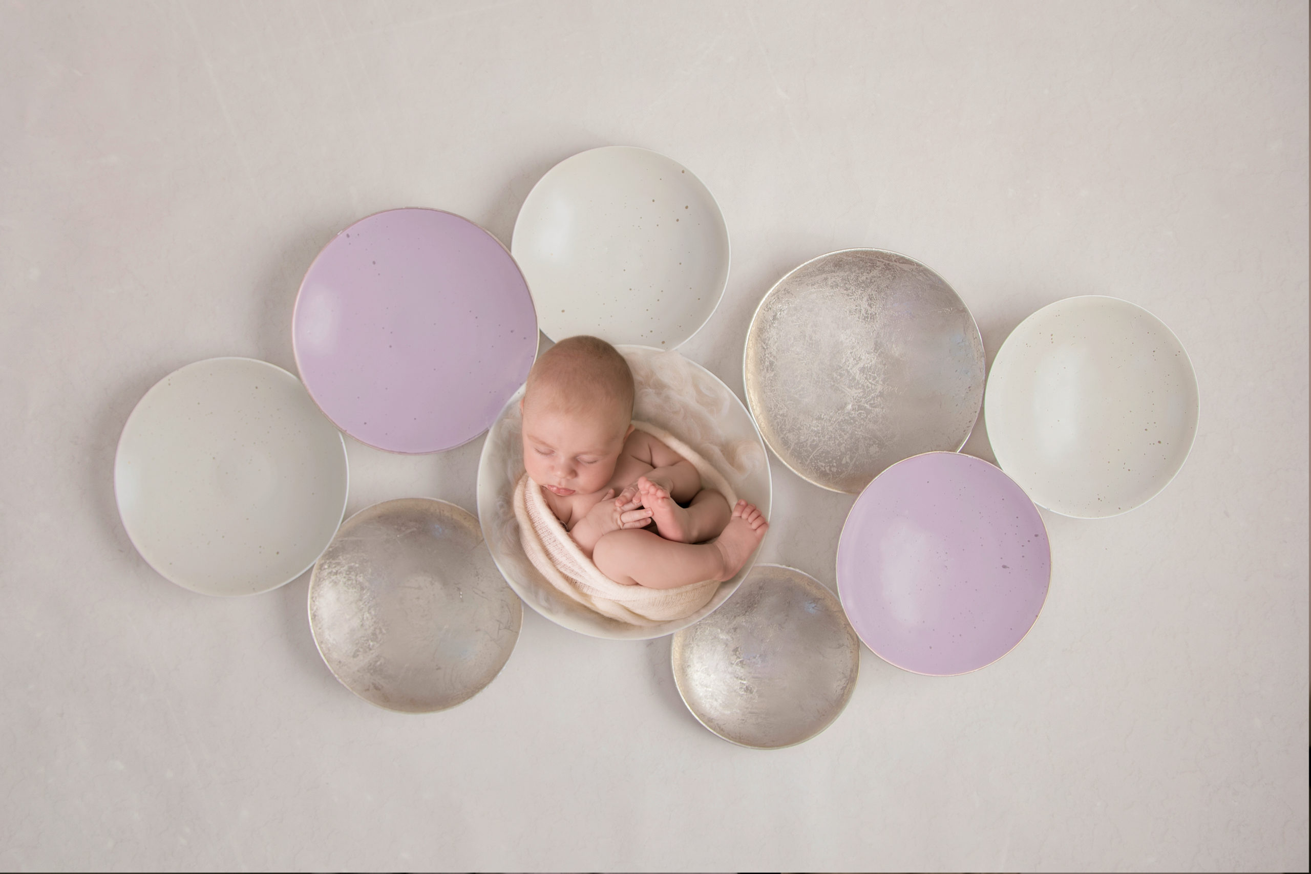Newborn photo session baby photography newborn baby in a bowl beige natural tones baby in cute outfit newborn photoshoot London Studio newbonr photography South West London Wimbledon SW19