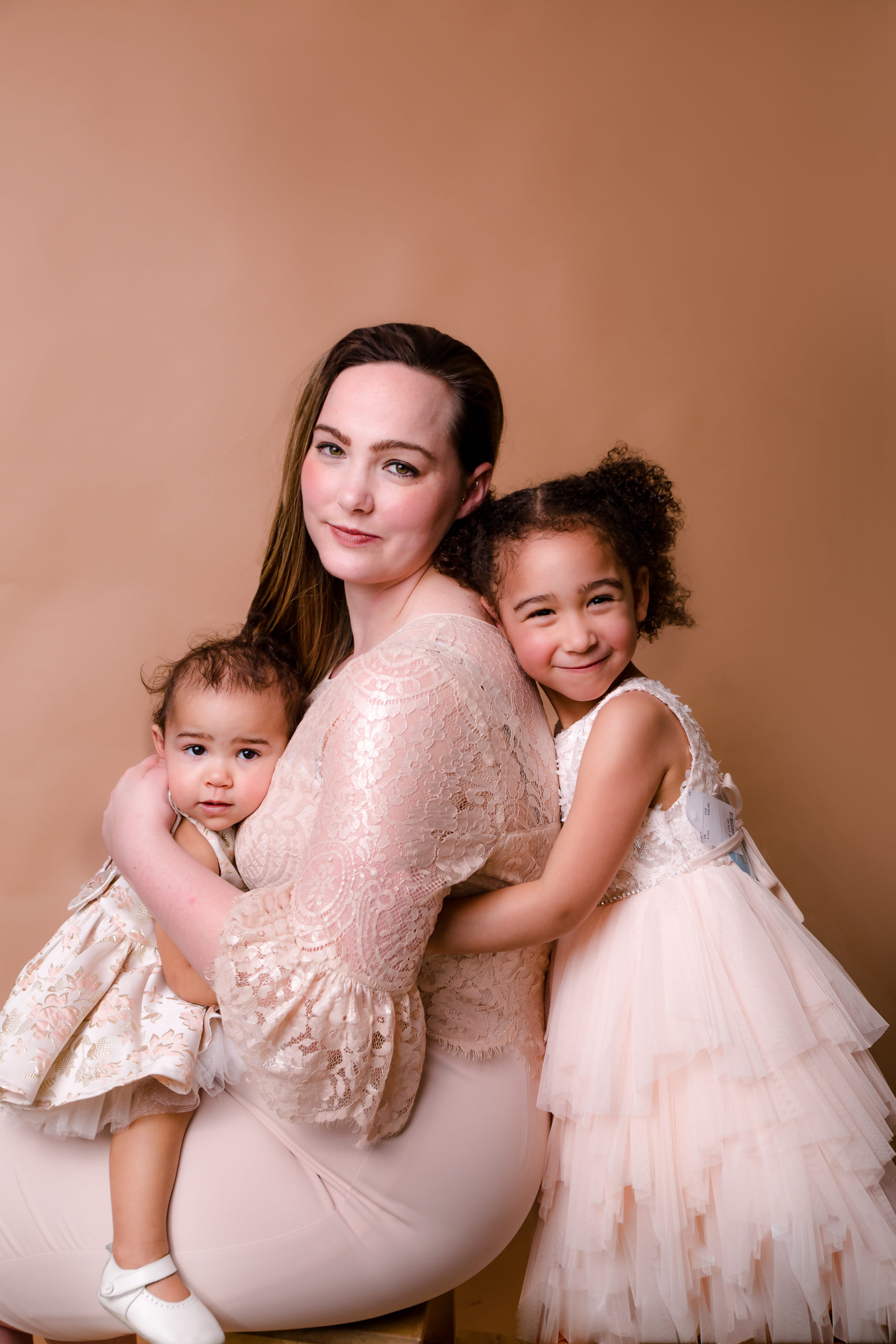 Family and children photographer in South West London SW19 family portrait photography Mother and her two daughters studio formal classic portrait