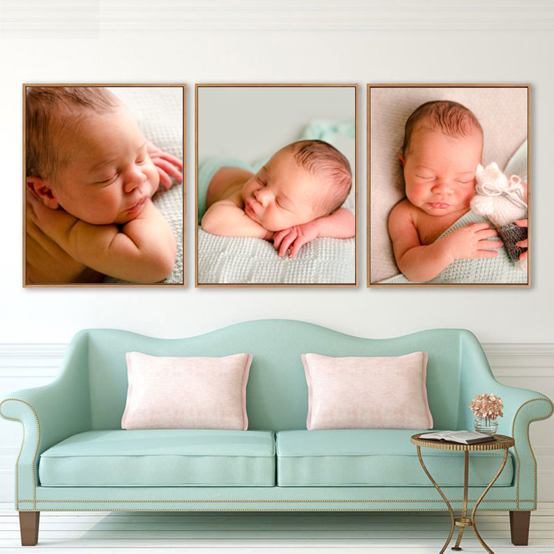 Newborn photography canvas and wall art in interior three photographs on a wall above sofa
