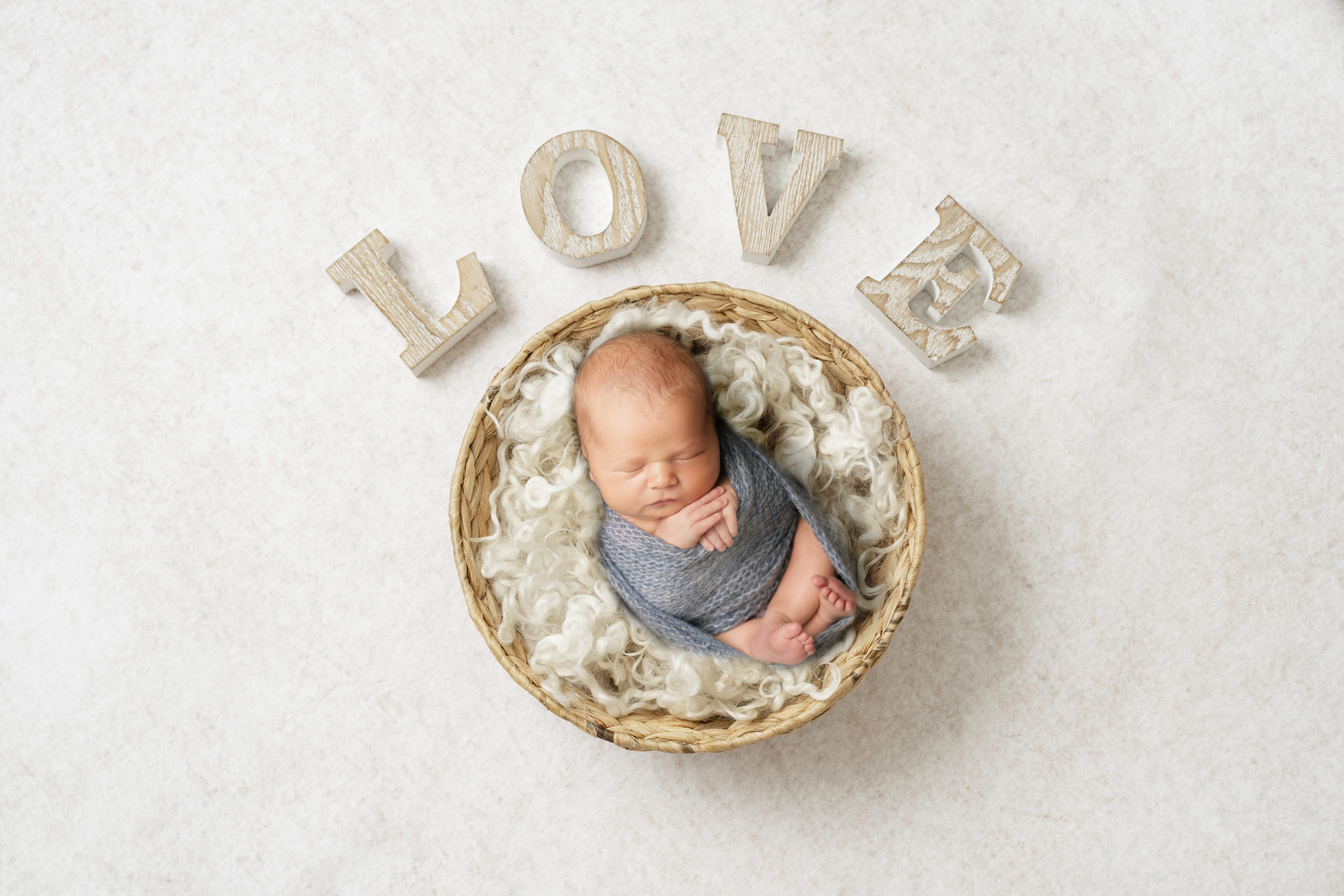 Newborn photosession baby in a bowl newborn photoshoot studio newborn photography in South West London Wimbledon SW19