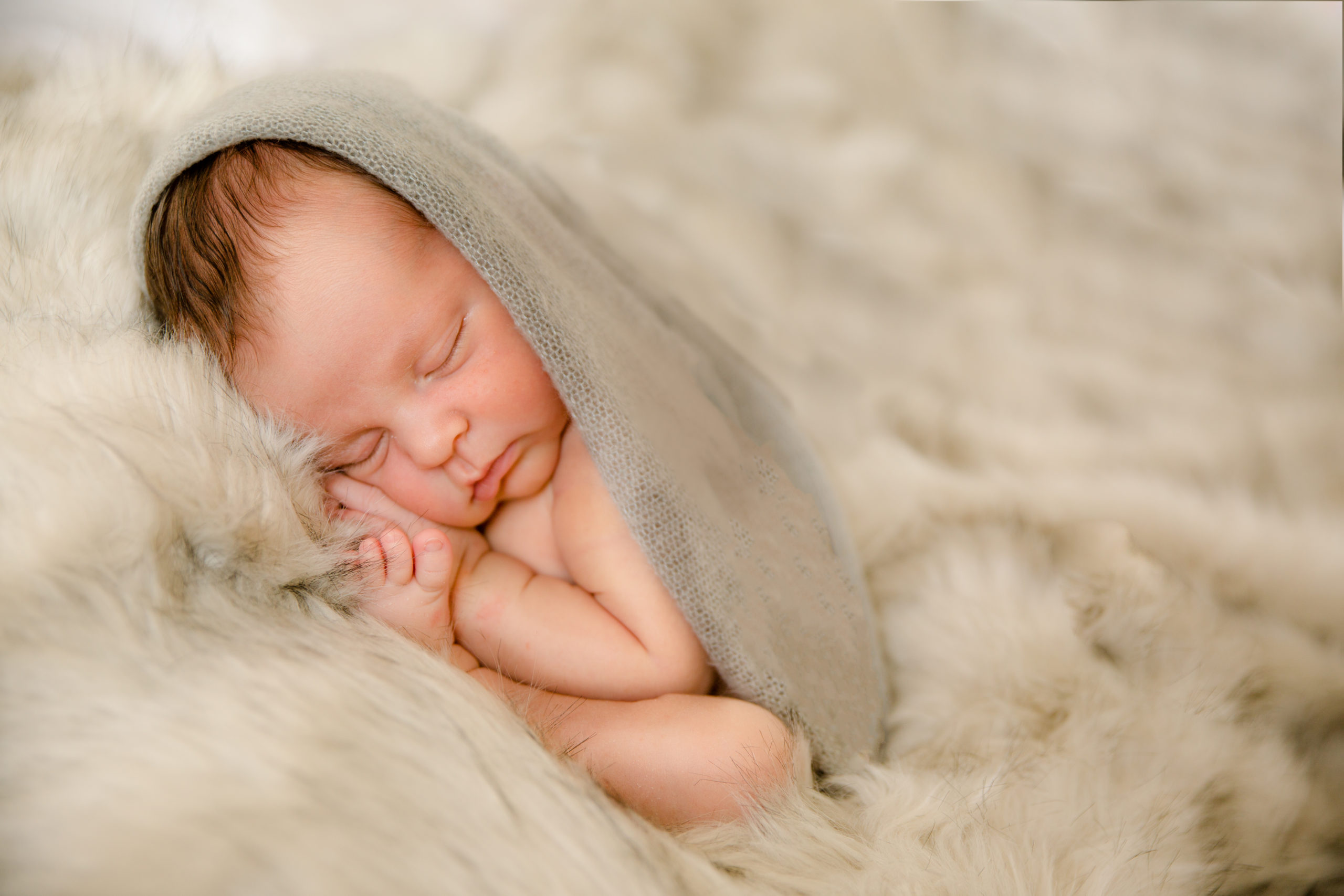 Newborn baby photography taco pose wrapped in grey blanket studio baby photo session baby boy first baby photo newborn photo studio in south west London SW19 Wimbledon