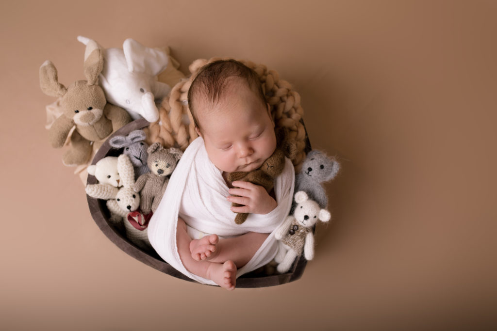 newborn photo session baby in a heart bowl with a white wrap studio photography Wimbledon SW19 South West London