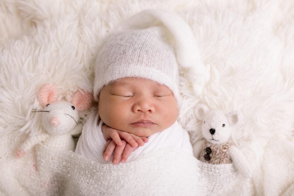 baby photo session with teddies sleepy pose white wrap studio photography Wimbledon SW19 South West London