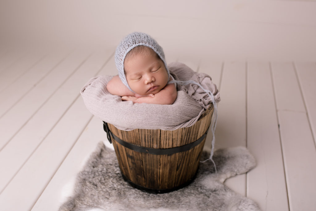 baby photo session in a bucket pose grey wrap grey hat baby girl in a grey studio photography Wimbledon SW19 South West London