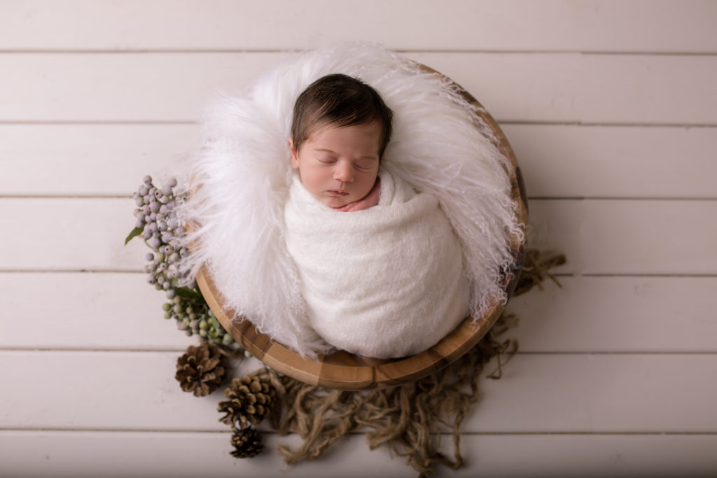 newborn photo session baby in a wooden bowl with a white wrap studio photography Wimbledon SW19 South West London