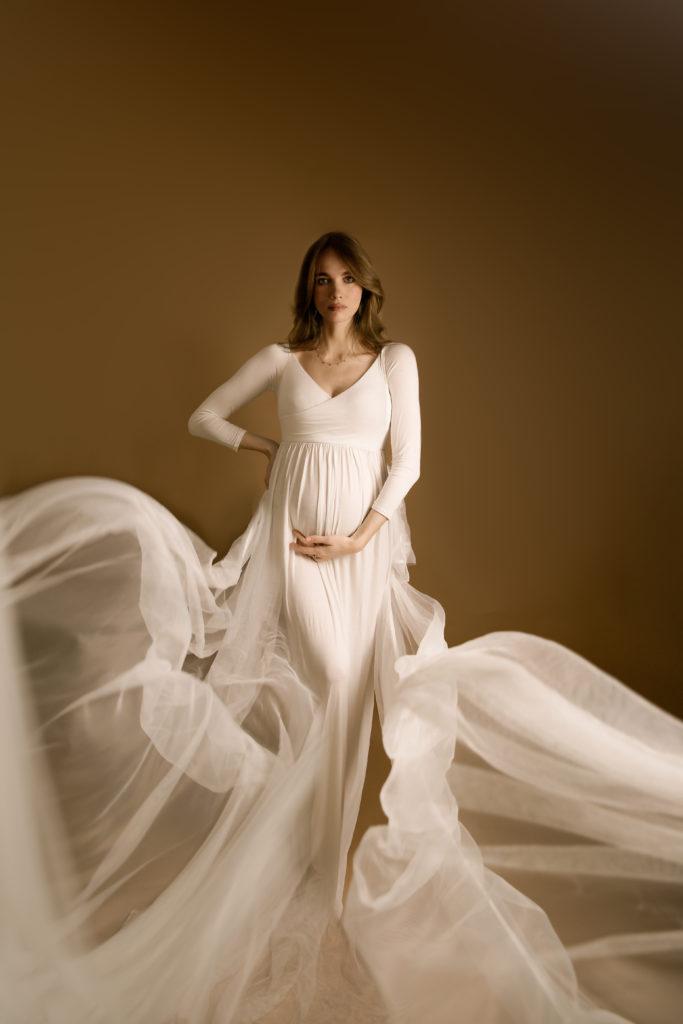 White Maternity dress with floating fabrics, Wimbledon photo studio SW19