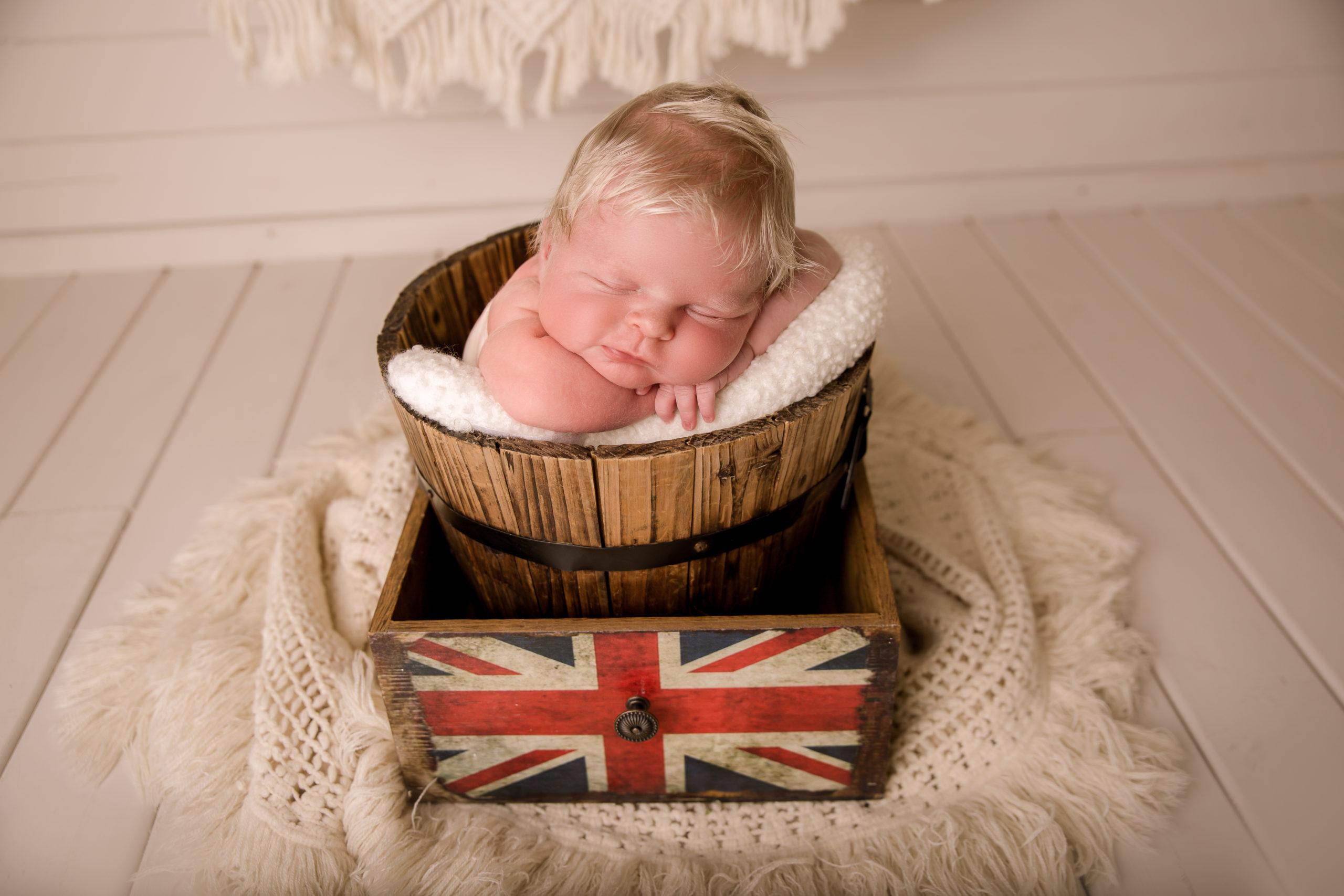 baby photography newborn boy in a bucket with British flag London photo studio in Wimbledon SW19